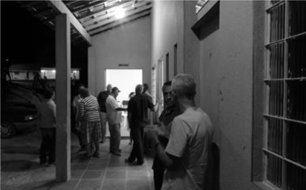 A group of farmers talking and sharing information and knowledge at the farmers' association head office, Tanguá, Rio de Janeiro